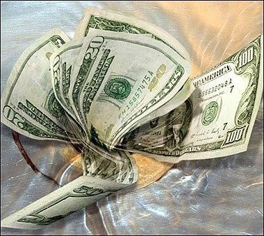 churn- money down the drain.jpg